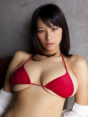 This gravure idols lingerie barely covers her big busty boobs