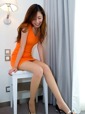 Ivy hot leggy babe in a very short minidress with high heels