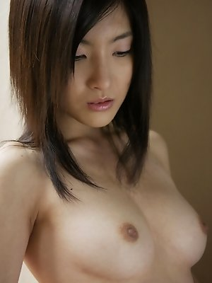 Adorable naked asian cutie with pig tails and plump petite boobs
