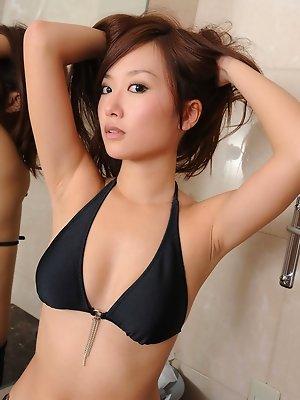 Ayako Yamanaka lifts up her minidress to expose her panties