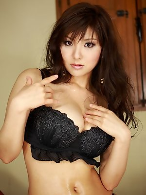 Gorgeous gravure idol can barely keep her tits in her lingerie